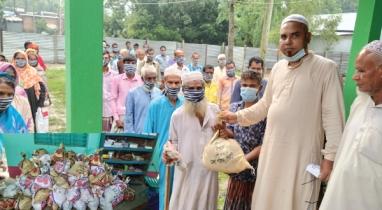 ঝিনাইগাতীতে ১শ অসহায় পরিবার পেল প্রধামন্ত্রীর উপহার সামগ্রী